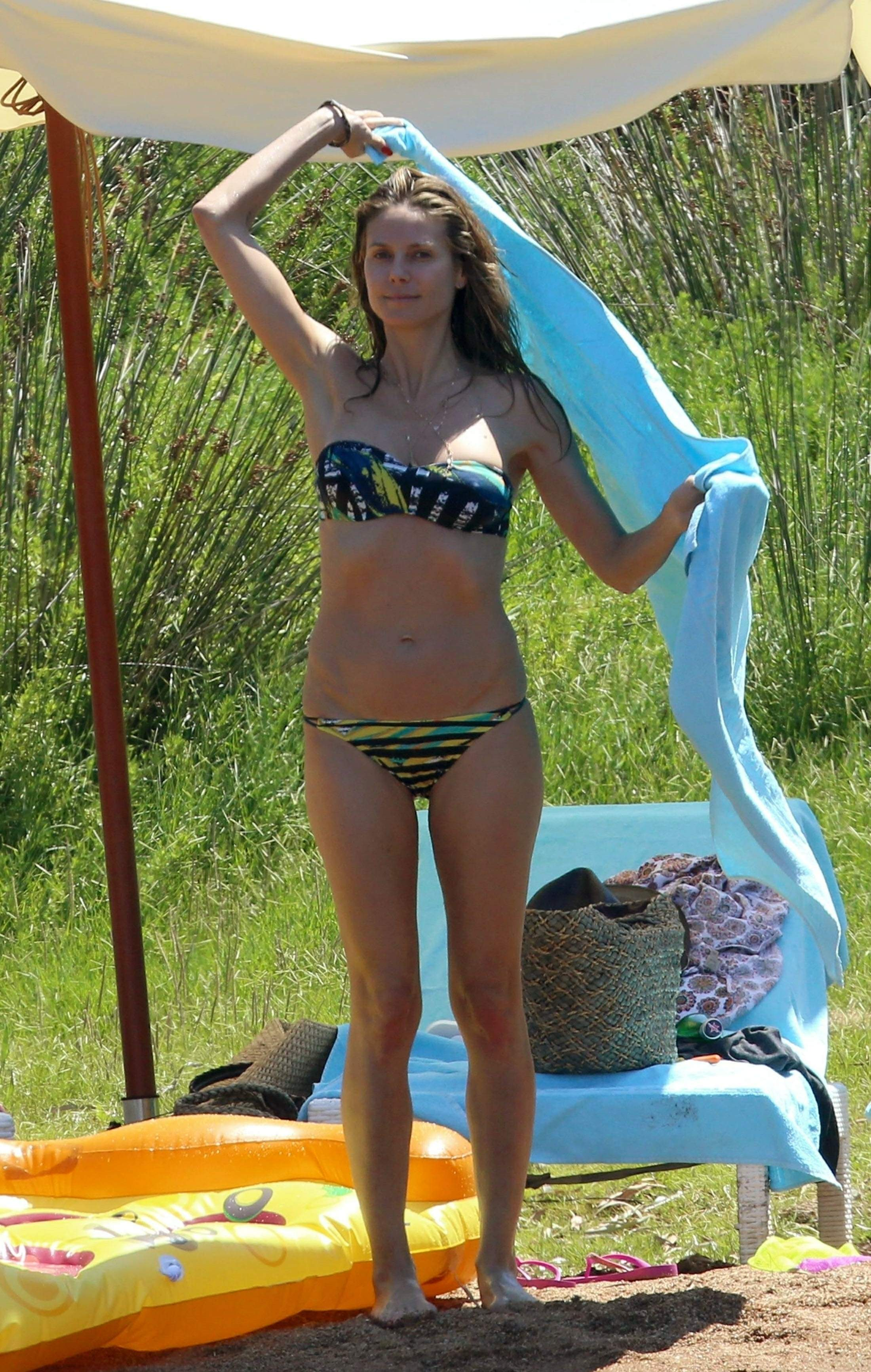 Heidi Klum day out at the beach in Corsica July 25-2018